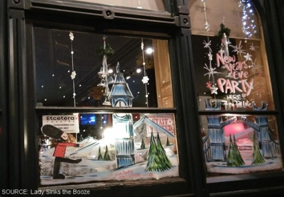 A pub window decorated for Christmas.