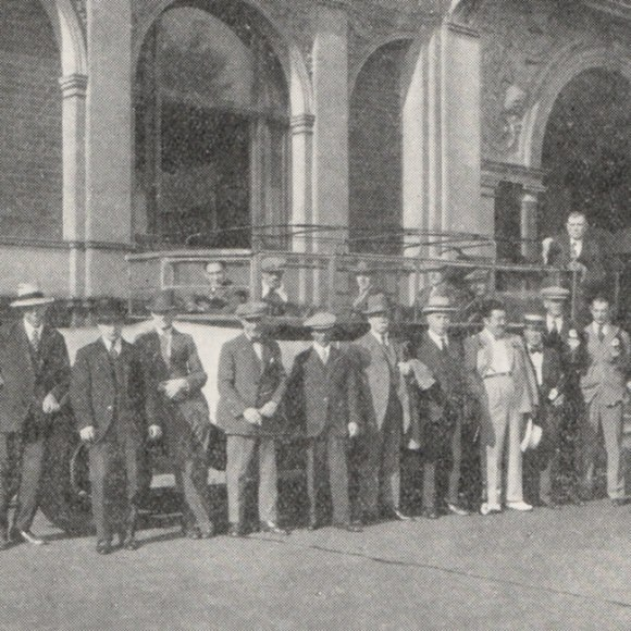 Men in front of a charabanc.