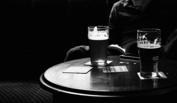 Pint glasses in a pub.