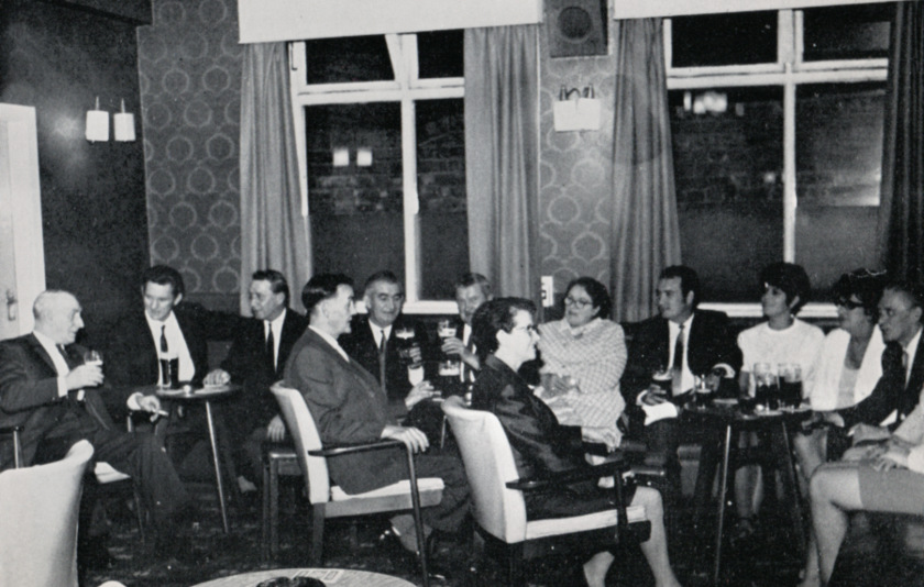 People drinking in a northern club.