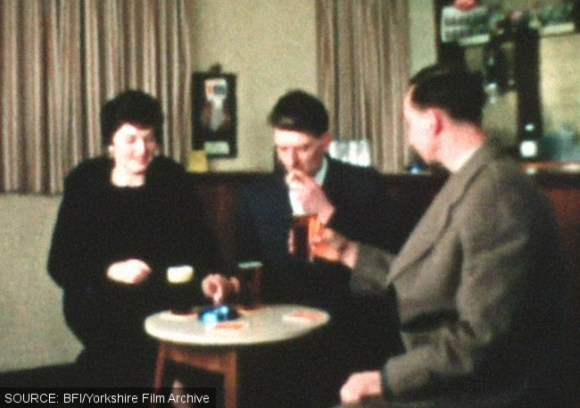Three people drinking in a pub.