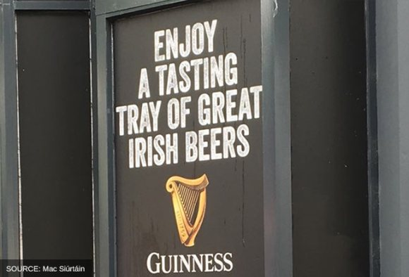 Pub sign advertising a tasting tray of Irish beers.