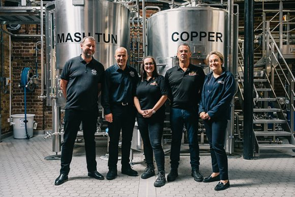 Fuller's pilot brewery with brewing staff.