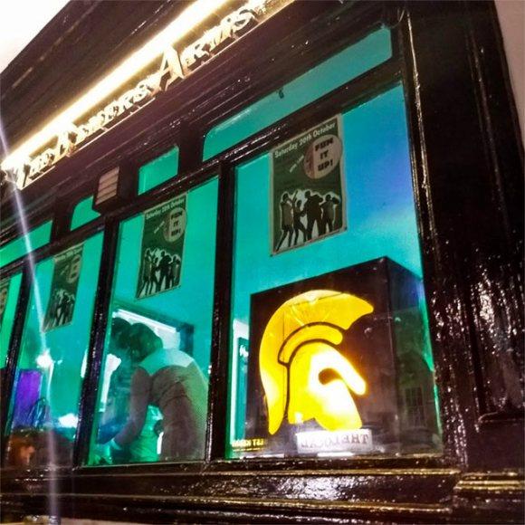 Ska DJs in a pub window.