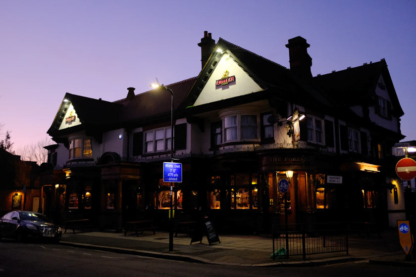 Pub exterior at night.