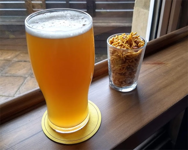 A pint of hazy beer.