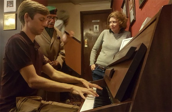 Playing the piano in a London pub.
