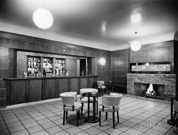 A sparse bar with fireplace.