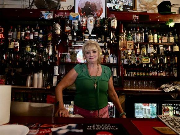 Barmaid/landlady.