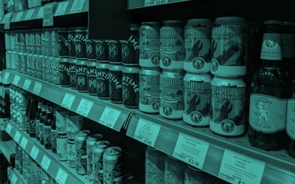 Beer cans in a supermarket.