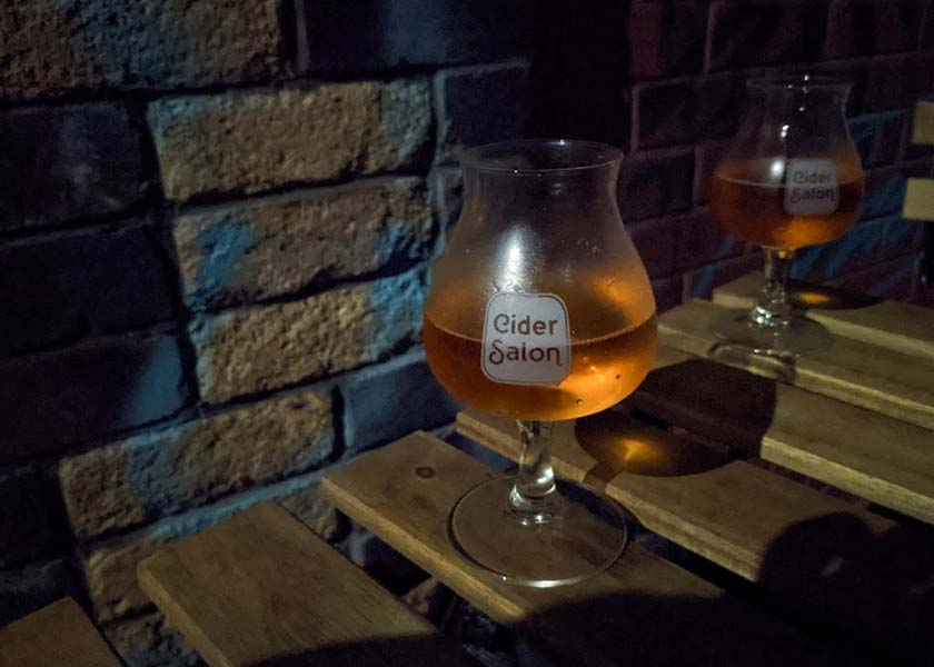 Two glasses of cider.