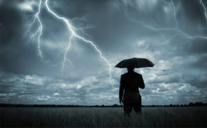 Businessman looking at stormy sky