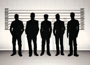 Black silhouetted police line up