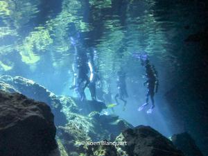 Divers preparing to descent in the cenote