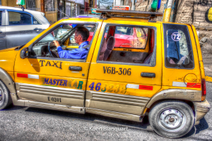 A taxi, making a way in the traffic of Arequipa, Peru.