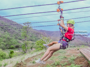Lieke, one of the Divemaster interns of Rich Coast Diving, ziplining.