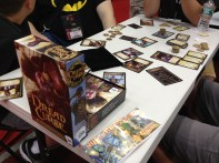 In the exhibit hall two of us sat down to try out Dread Curse. This was a neat role selection pirate game that can play up to 8 players.