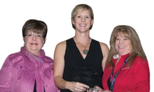 Last year's winner, Debbie Meigs, with Chupich and Kathy Johnson of Boating Industry. (Photo by Universalimage.net)