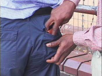 A pickpocket demonstrates a speedy back-pocket steal.