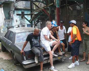 Muggers in Colon, Panama: Seeking a little privacy, we move the two gangsters and our translator to a nearby alley, but others follow, curious.