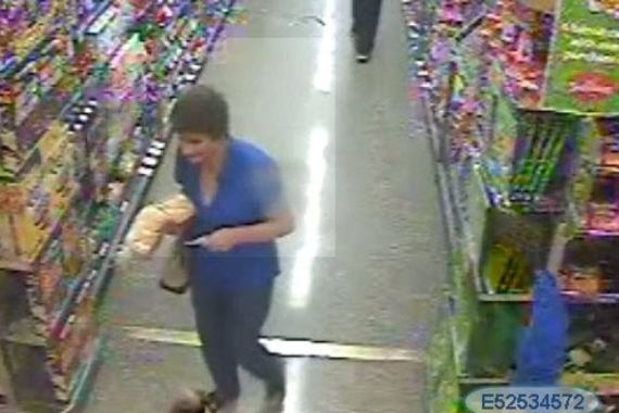 Shopping cart pickpocket steals wallets from unattended purses in shopping trolleys.
