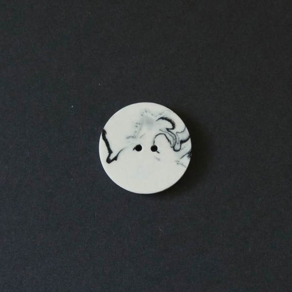 black and white marbled jesmonite buttons