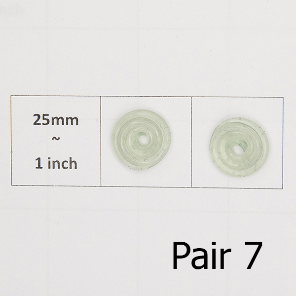 pair of spiral glass discs on a 25mm grid