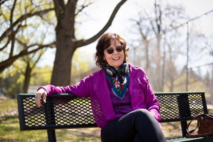 Bobbin Beam Voice Over Artist Bio park bench with headphones