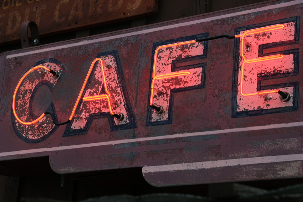 Old rusted neon cafe sign.