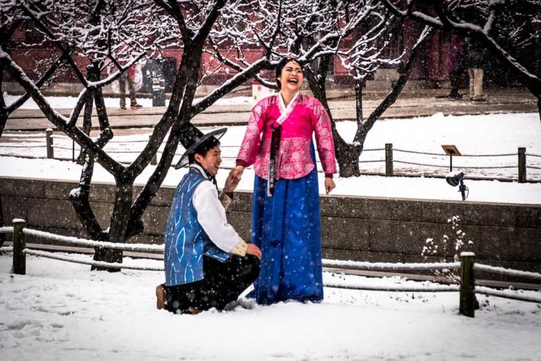 Couple Laughing During Professional Shoot at Gyeongbokgung Palace during snow