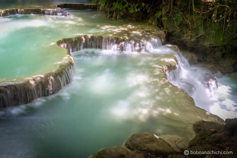 Cascading waterfalls at Kuangsi Waterfall