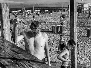 Bech kids taking shoer on Coco Beach, Florida