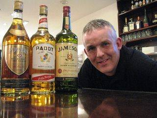 Bartender Emmet Rodgers, a native Irishman working in Grimaldi's in Hoboken, N.J., said he's happy Paddy and Powers whiskies are now on his bar shelf alongside Jameson (Bob Sullivan photo).