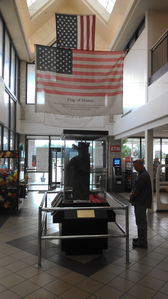 At a rest stop in Nebraska, a piece of the World Trade Center and a Flag of Honor.
