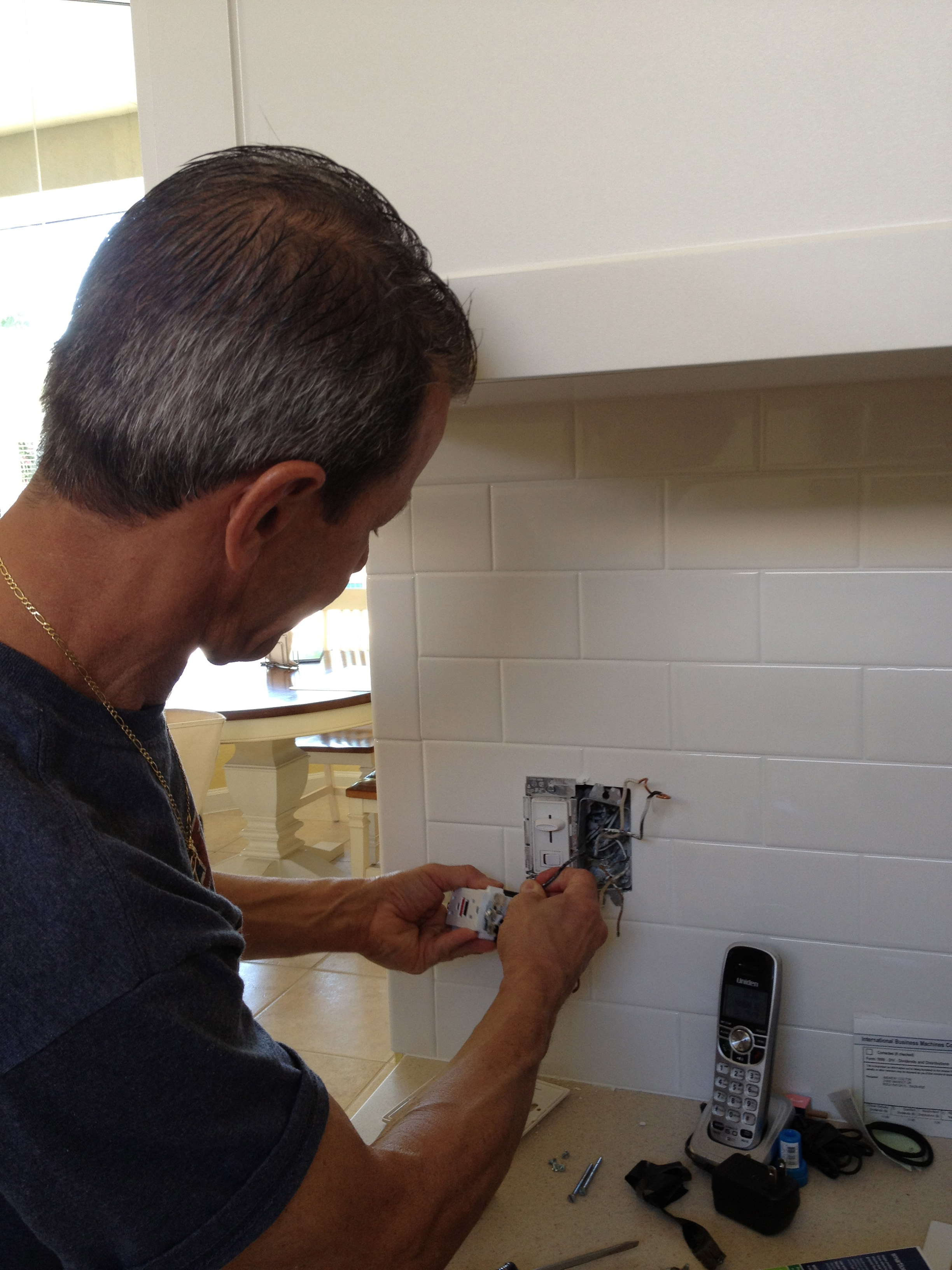 Electrician Allen Shapiro Determining Why a GFI Circuit Tripped in a Boca Raton Home.