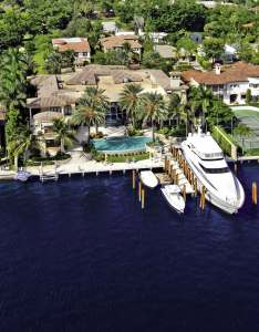 This gorgeous estate at 750 Lake Drive in Boca is listed by Mizner Grande Realty.