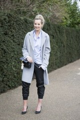 Anouk Bos in a JW Anderson shirt, Zaliah trousers and Sergio Rossi shoes with a Warehouse coat