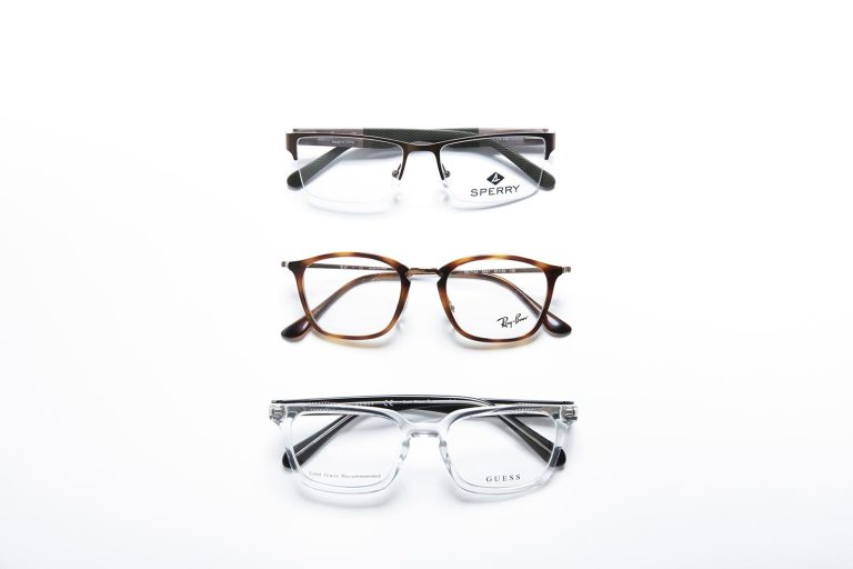 Men's Sperry, Ray-Ban, and Guess eyeglass frames on a white background
