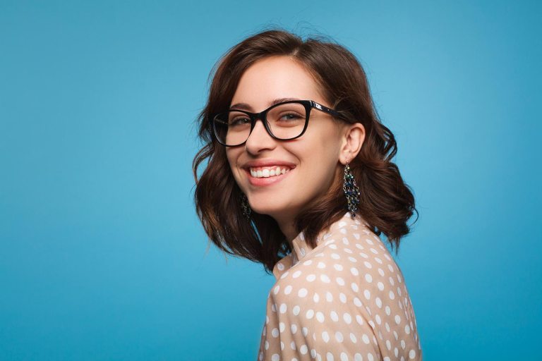 Brunette woman modeling trendy glasses