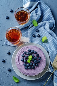 Raw vegan Blueberry Cashews cake on a stone background for losing weight.
