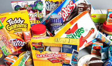 a table full of packed processed foods
