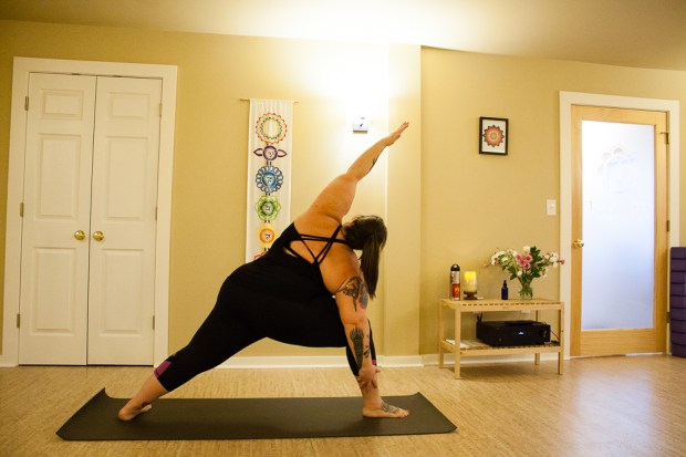 Me in side angle pose wearing Sore Not Sorry Capri (top is from Athleta)
