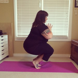 An image of me, a fat, tattooed, white woman in a toe-balancing yoga posture.
