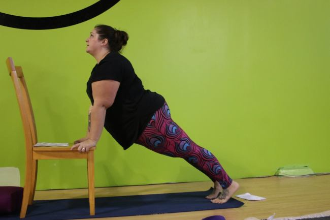 Upward-facing dog with a chair