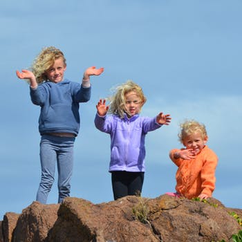 Children with arms outstretched.