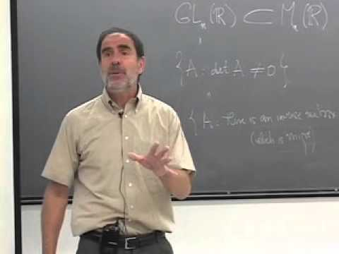 Benedict Gross standing in front of chalkboard with equations from Abstract Algebra Class