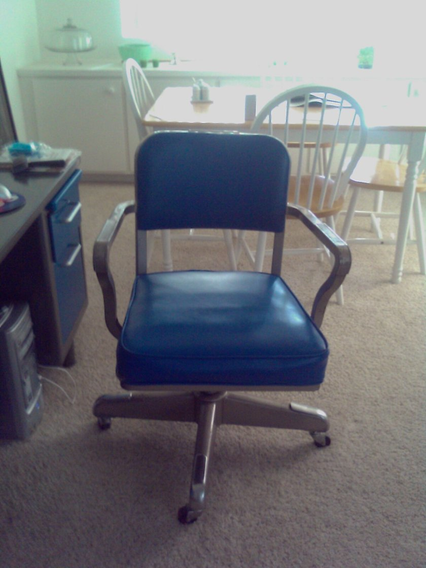 Partially refinished tanker desk chair with blue upholstry