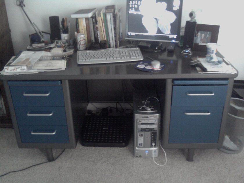Finished Executive Tanker Desk in gunmetal grey with blue highlighted drawers