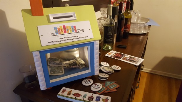 You too can make a donation to The Literacy Club. On the table: bookmarks, pins, and magnets supporting the Little Free Library movement.