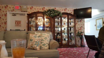 You have to love the way the interior decorator has highlighted the tchotchkes with the lovely floral print wall paper, the couch, and the throw pillows. The restraint in not doing a floral print on the couch was superb!